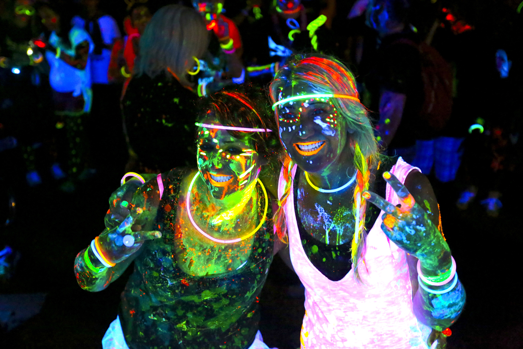 DECEMBER, 08, 2013. Two girls show off their glow at the after party of the glow run held in east london over the weekend. picture: STEPHANIE LLOYD. © DAILY DISPATCH
